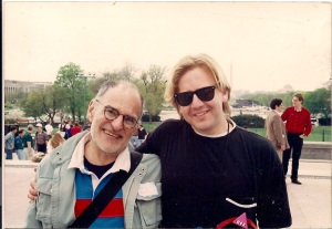 The day Larry Kramer hugged me. The day before the National March on Washington, 1993. It was outside the Capitol Building where Larry Kramer had just passionately delivered a speech to a crowd of LGBT Activists. ACT UP had just organized us in wrapping a giant red ribbon around the Capitol Building. After the building was wrapped, the ribbon broke into hundreds of little pieces. I attached my piece to my ACT UP KC button.