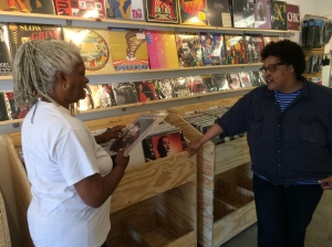 Necia talks with Marion about records.