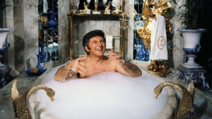 28 Jan 1978, Los Angeles, California, USA --- Liberace spoofs a day in his own life during a television special, including a scene where he baths in his $55,000 marble bathtub. --- Image by © Bettmann/CORBIS