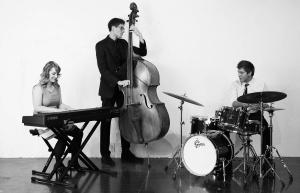 The AM Trio with Alysssa Murray on voice & piano, Joel Stratton on bass, and Josh Blythe on drums & vocals.